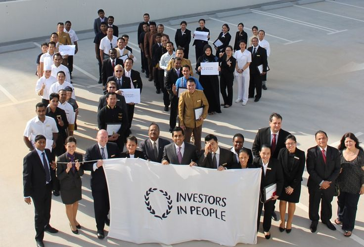 Dusit Thani Dubai staff celebrating IIP Silver