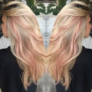 Pastel pink highlights in blonde hair