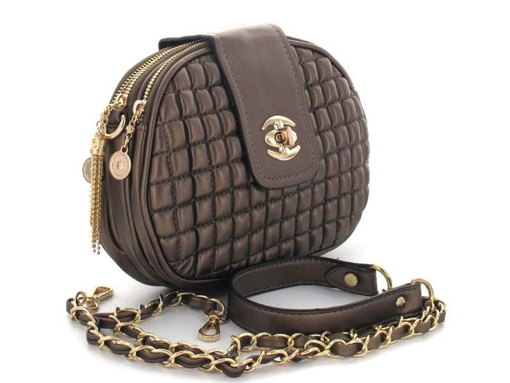 Bronze Quilted Double Zipper Crossbody - A multi-functional bag with double zipper enclosures, allowing for greater organization. The chainlink strap can be removed and the bag carried as a clutch. Perfect for the daytime, as the crossbody design allows for effortless hands-free style. Easily turns into an evening bag by simply removing the chainlink strap.   Available in; Bronze and Silver.