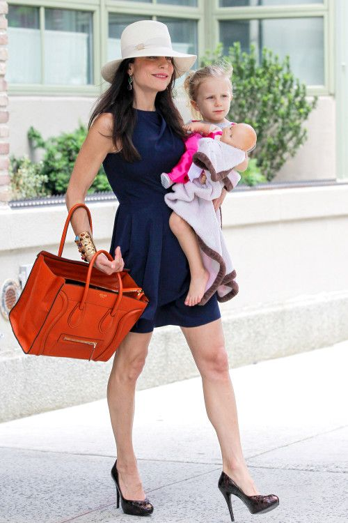 Bethenny Frankel heads out for the day with a smile