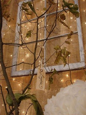 "Design idea -- Lights peeking through a burlap wall and natural and vintage elements.   What a beautiful backdrop this would make for a nativity show.  This was originally created for a barn wedding found on the blog ""Cobblestone Farms.""  #burlap  #nativity"
