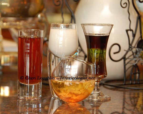 Four Halloween Shots - Hellraiser layered shot, Bloodied Brains shot, Friendly Ghost shot, Vampire shot. Look into the crystal ball of spirited Halloween shots and pick your poison. {photo credit: Mixologist Cheri Loughlin}