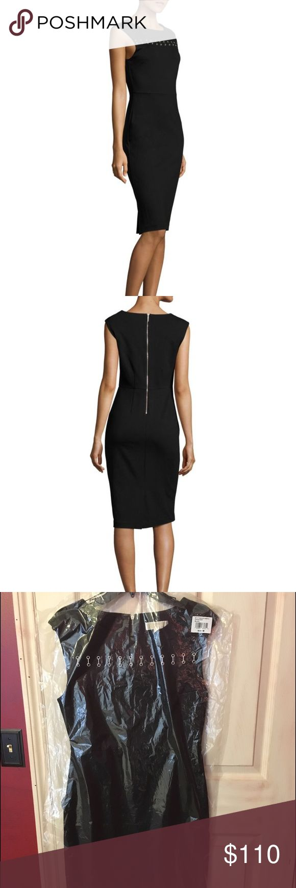 Michael Kors black shealth dress A grommet and bar design across the front yoke adds a contemporary touch to this polished sheath dress. SKU: 8882541 Seaming details create a structured look. Round neckline. Sleeveless construction with extended shoulders. Exposed back zipper closure. Bosom darts. Back vent. Straight hemline. 69% viscose, 27% nylon, 4% elastane. Machine wash cold, dry flat. Imported. Product measurements were taken using size SM. Please note that measurements may vary by…