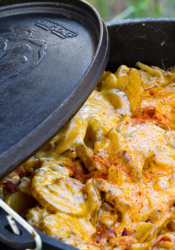 Easy Dutch Oven Potatoes | These potatoes are unbelievably delicious for how easy they are to make. After all, when the main ingredients are butter, cheese, bacon and potatoes, it's pretty impossible to not create something delicious. | http://www.campchef.com/recipes/easy-dutch-oven-potatoes/ |