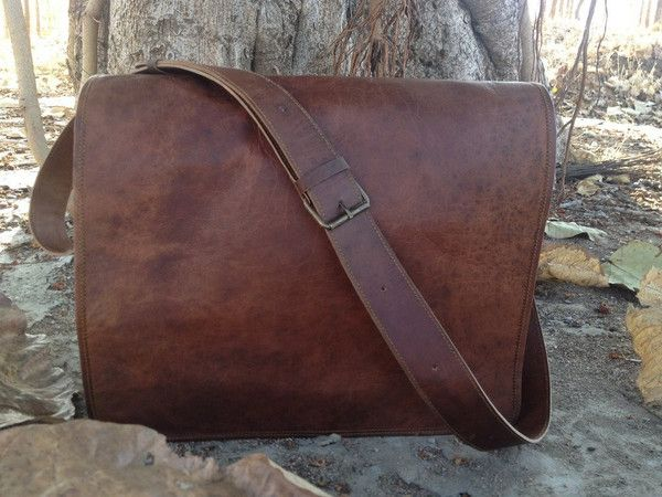 A must have classic retro style laptop/college messenger bag. This bag comes with two inner compartments and two inner zipper pockets each on the inside and also have a adjustable shoulder strap . This bag has enough room for your books, laptop, files and other essentials.   Dimensions: (WxHxD) 15x11x4 Inches (38x28x10 cms). Can easily accommodate a 14 inch macbook pro and other laptops