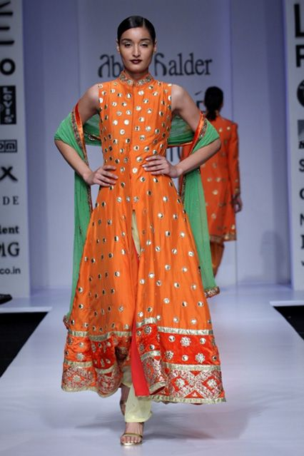 Love this orange, polka dot anarkali | abdul halder http://www.abdulhalder.com/