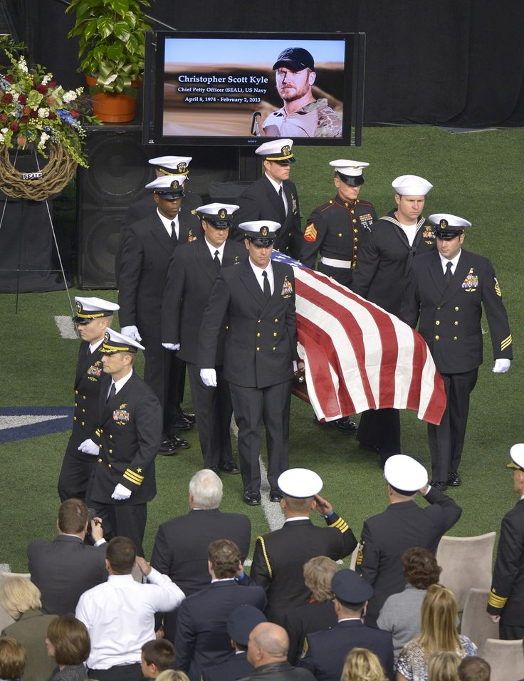 Members of the military carry the casket of Chris Kyle.