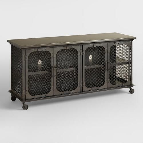Exuding an industrial appeal, our TV stand features an all-metal frame, locking caster wheels and ample storage for media components, electronics and more with two large shelves behind cage doors.