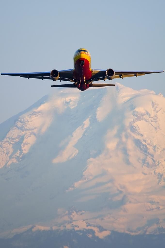 DHL B767-281 freighter climbs out from Seattle Boeing Field in front of Mount Rainier
