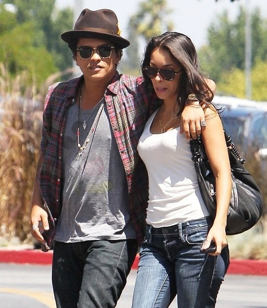 Bruno Mars, he's definitely off of the market. He recently went 'public' with Latina model/actress Jessica Caban. The two have been dating for a year.