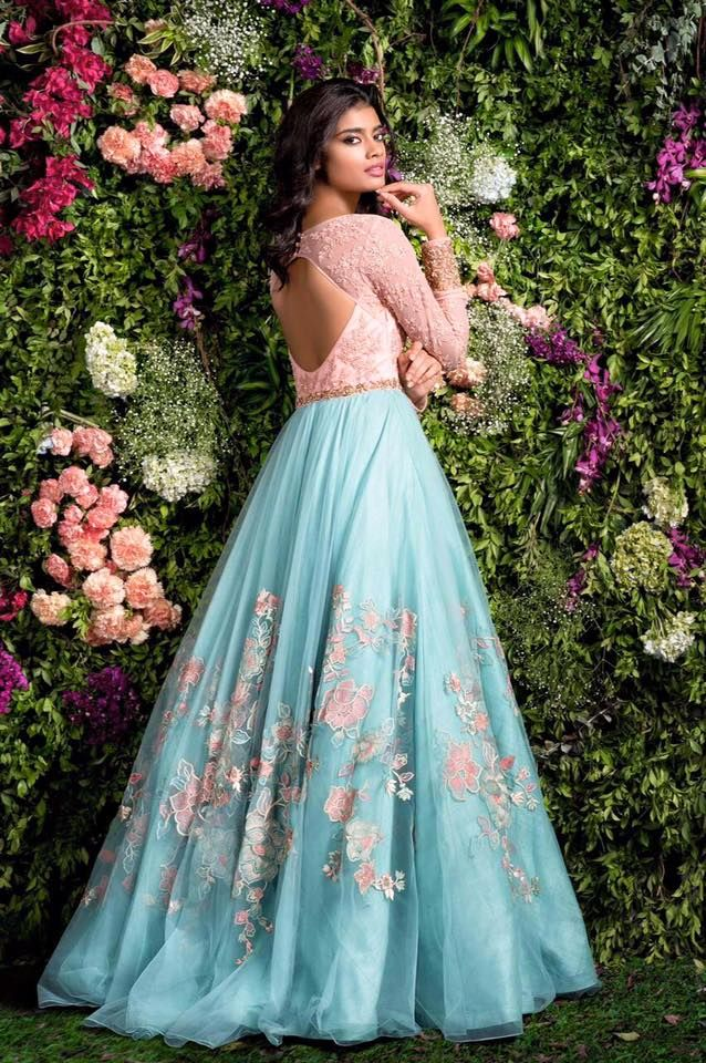 A blush pink and blue gown with thread work and hints of antique zardosi is the perfect outfit for a day wedding.