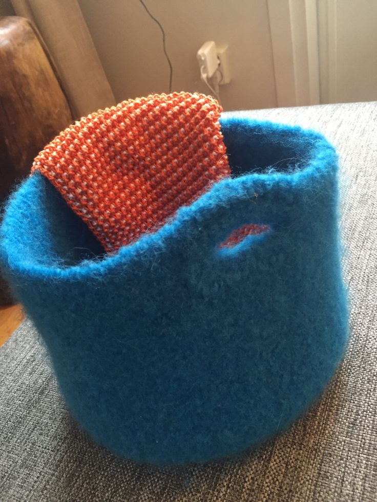 Homemade basket to store yarn Resting on the edge is my latest work in progress; oven-mittens for easter