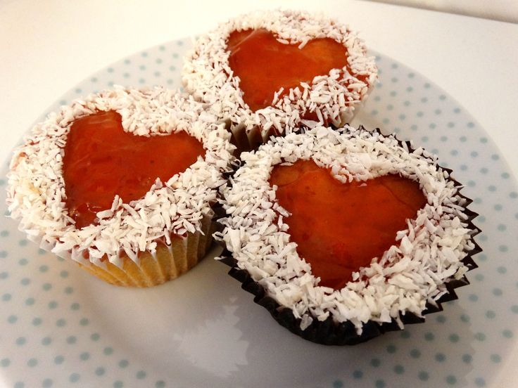 Jam and coconut heart cupcakes - vanilla sponge topped with jam and desiccated coconut. #cupcakes #jam #coconut