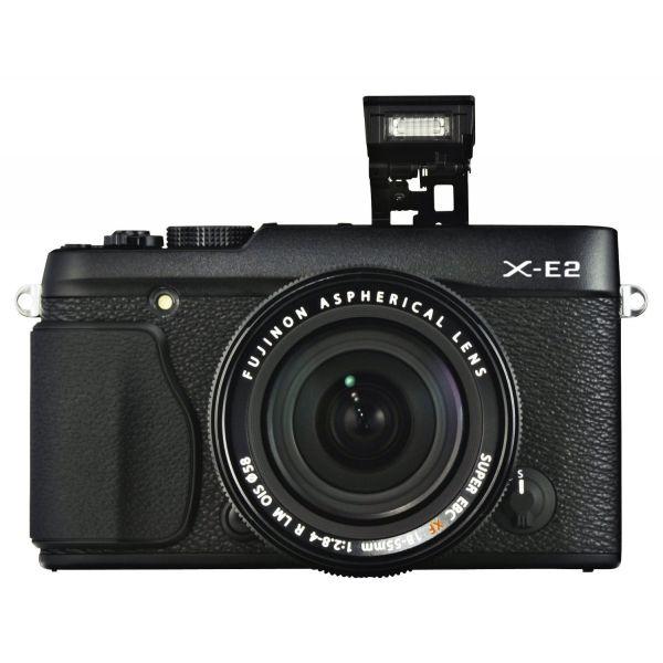 #Fujifilm FinePix X-E2 digitális #fényképezőgép XF 18-55 mm objektívvel.  A FinePix X-E2 az X-E1 továbbfejlesztett változata, mely előnyeit megtartva, a róla beérkezett észrevételeket figyelembe véve alakították ki a széria új tagját. A retró kinézetű házban az X-Trans CMOS II képérzékelője és a kétszeresre növelt sebességű EXR Processor II található. Bekapcsolás után fél másodperc alatt ébred fel, sorozatfelvételnél 7 képet tud rögzíteni másodpercenként 4 másodpercen át.