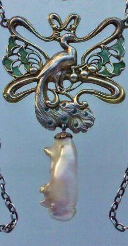 JANVIER QUERCIA Art Nouveau Peacock Pendant Gilded silver Plique-à-jour enamel Pearl Pendant: H: 6.5 cm (2.56 in) W: 4 cm (1.57 in) Chain: L: 55 cm (21.65 in) W: 0.7 cm ( in) Marks: Makers mark: 'JQ' with an oak leaf French, c.1900