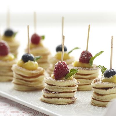 Adorable Mini Pancake Stacks, There isn't a recipe here...BUT!!! the photo gives an Idea i hadn't thought of and thought you might appreciate the breakfast buffet idea as well. Great idea dontcha think?1 ;-)  Found at: stonewall kitchen, where they have other great ideas.
