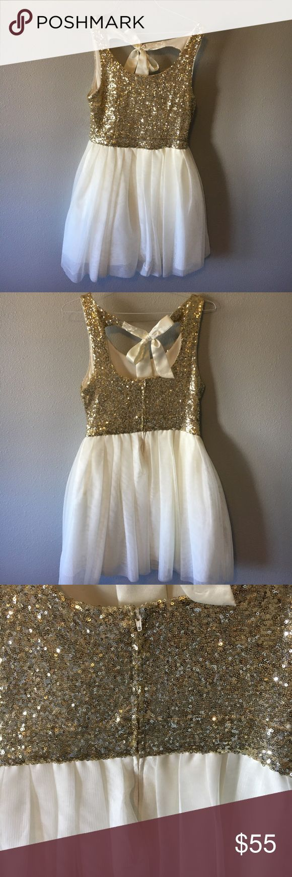 Occasion Dress Sequined gold occasion dress with tulle bottom and bow in back. Worn only once B. DARLIN Dresses