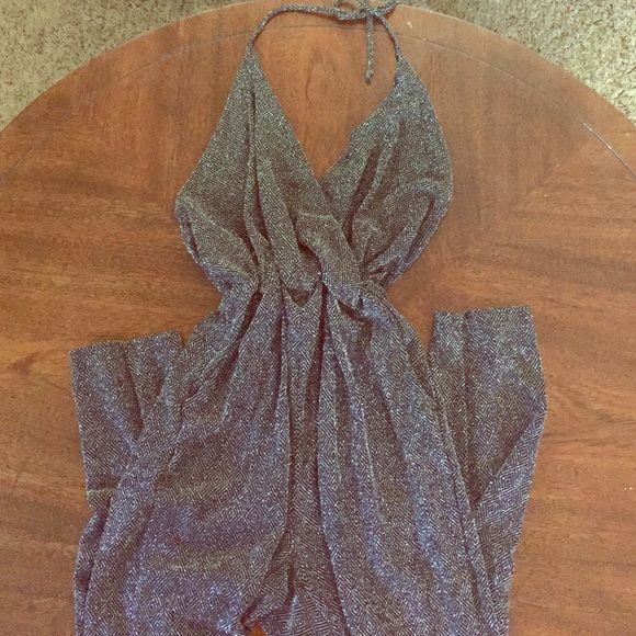 Silver jumper Sparkly silver jumper that is tied around the neck. Great for a night out! Work only once. Charlotte Russe Other
