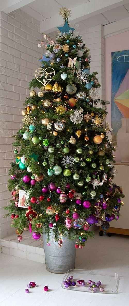 A rainbow tree - rather than splitting up various sets of ornaments, display them together and coordinate colors from one section to another.