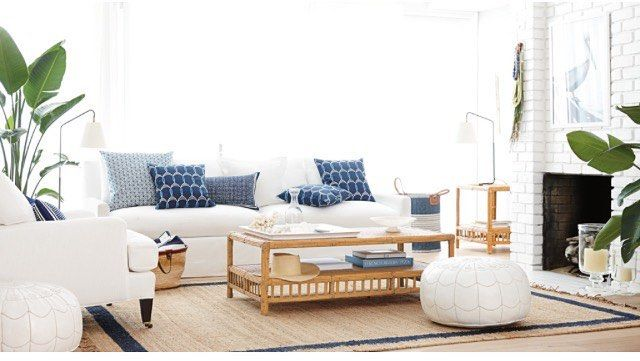 Comfortable beachy living room from Serena and Lily. White and indigo, rattan, palms.