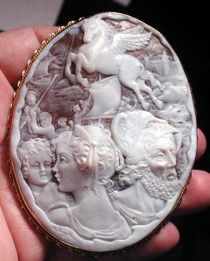 This is a huge and fine cameo of Zeus and Hera. There is Pegasus flying over a ship.  A baby to the left may be Bacchus.  Also 5 sailors and a castle.The size is 2 7/8 by 3 3/4.