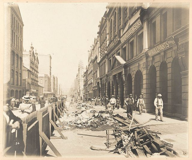 """When bubonic plague struck Sydney in 1900, George McCredie was appointed by the Government to take charge of all quarantine activities in the Sydney area, beginning work on March 23, 1900. This is a view of Kent Street during """"cleansing operations"""", Sydney."""