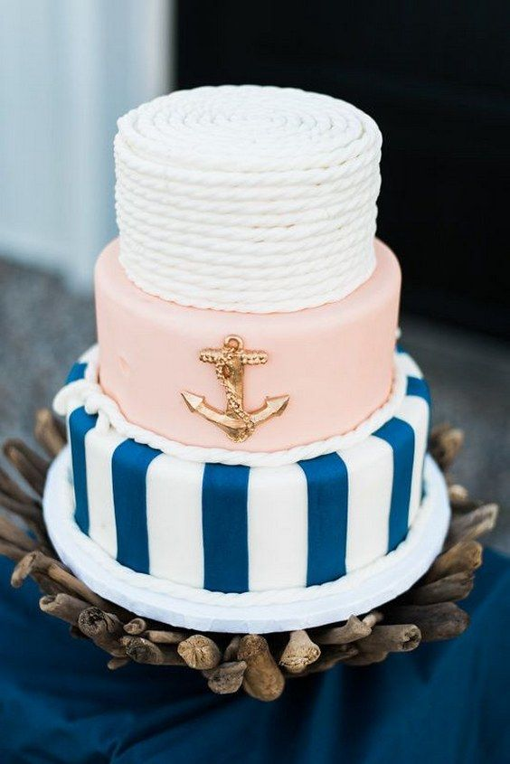 Nautical wedding cake / http://www.deerpearlflowers.com/incorporate-anchors-into-your-nautical-wedding/