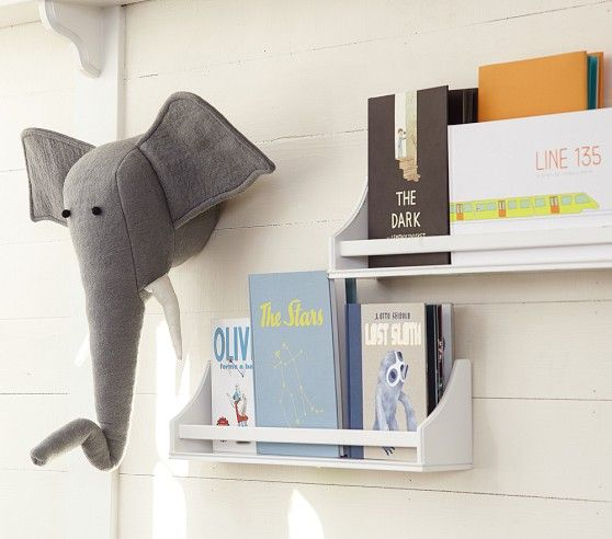 Love everything about this nursery wall!  The board wall, the stuffed elephant head, and the book shelves.  Super cute <3