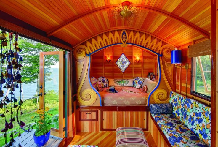 The gypsy caravan was a collaboration between owner Gail Bertuzzi, landscape architect George Workman, and boatbuilder Rene Goulette. Workman painted the decoration around the sleeping nook inside. Goulette's woodworking skills are evident throughout.