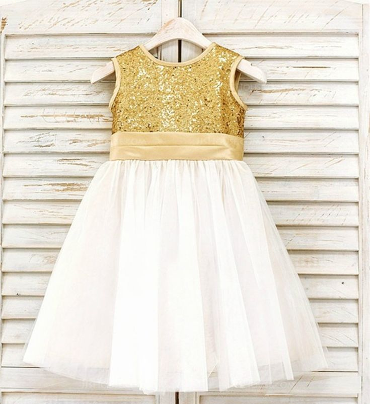 Sequin Little Girl Tutu Dress-Ivory Knee Length Gold Sequin Big Bow Back Flower Girl Dress Material: Tulle mesh, sequin, cotton, satin Available from 6 months - 14 years A matching sequin headband also come along with the dress Custom colors are available upon request Please do compare your  little girl measurements with our size chart below before deciding her size or you may leave a note your little girl's height, bust and waist measurements so we can process it and send you the right…