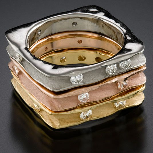 Stack of 3 rings 18k yellow gold, 14k white gold, 14k rose gold,  7 diamonds on each