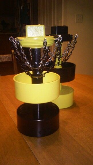 """Tabletop, bottlecap disc-golf baskets out of reclaimed and new PVC, chain, hooks and old keyrings. Center post hollow with holes for adding a glo-stick for """"night putting"""""""