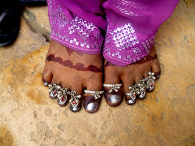 Woman's feet painted with henna in Jaisalmer Fort
