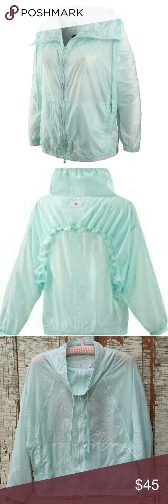 "Adidas Stella McCartney Barricade workout jacket Stella McCartney Adidas barricade workout windbreaker jacket. Sheer/aqua color.  Zippered pockets and drawstring neck with dolman sleeves  Shoulders- 20"" Bust-25"" Length- 23"" Arm Inseam-19"" Adidas by Stella McCartney Jackets & Coats"