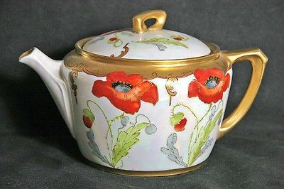 Tea for two anyone? This cute teapot is a petite 4-1/2 inches high and 7-1/4 inches across the handle. It is hand painted by one of the Keates (Alfred or Madeline) in the Poppy Conventional pattern: r