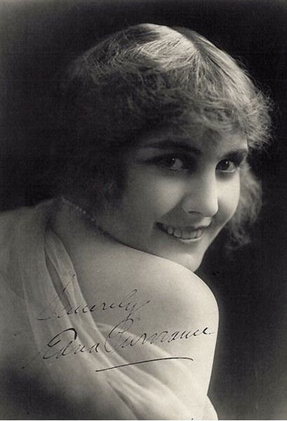 """Chaplin was looking for a leading lady for """"A Night Out"""" (1915) when one of his associates noticed Purviance at a Tate's Café in San Francisco and thought she should be cast in the role. Chaplin arranged a meeting with her and although he was concerned that she might be too serious for comedic roles, she won the job. Purviance went on to appear in 33 of Chaplin's productions, including """"The Tramp"""" (1915), """"The Immigrant"""" (1917), """"Easy Street"""" (1917), """"The Idle Class"""" (1921)"""