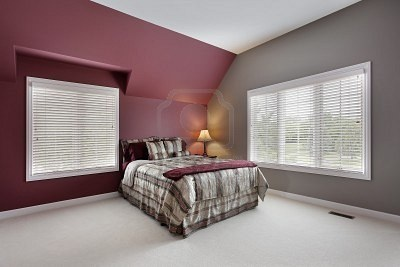 Maroon accent wall with gray other walls - maybe for the den?