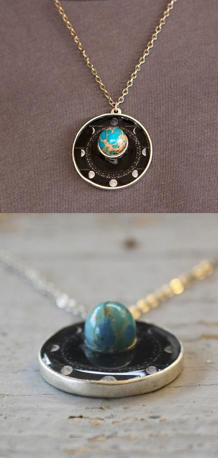 Phases Of The Moon Necklace Not that I would wear this, but this is really neat...