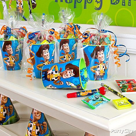 Fill Toy Story Party Cups with out-of-this-world Toy Story favors and they're ready to go!