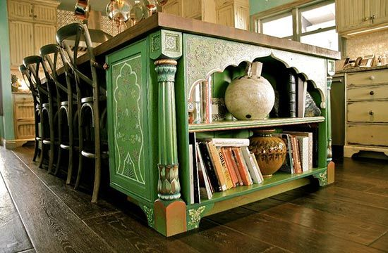Green kitchen island with decorative painting by Kaveri Singh | Painting and arch inspired by designs from India | Interior design by Joanna Poitier of JSP Interiors