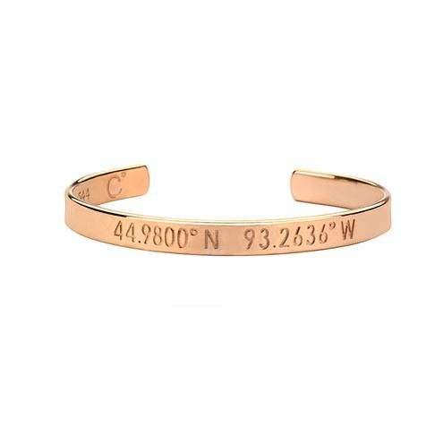 The bracelet is engraved with the exact coordinates of a special location (first date, place where a child was born, proposal spot, etc.) on the front and a personalized message on the inside.
