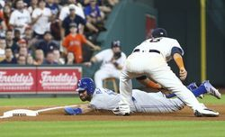 Aug 5, 2017; Houston, TX, USA; Toronto Blue Jays center fielder Kevin Pillar (11) slides into third base as Houston Astros third baseman J.D. Davis (28) attempts to tag during the seventh inning at Minute Maid Park. Mandatory Credit: Troy Taormina-USA TODAY Sports