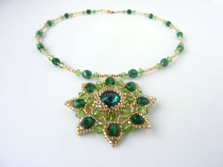 DIY Jewelry: FREE beading pattern for stunning necklace featuring a central 14mm rivoli crystal surrounded by petals of smaller crystals and seed beads