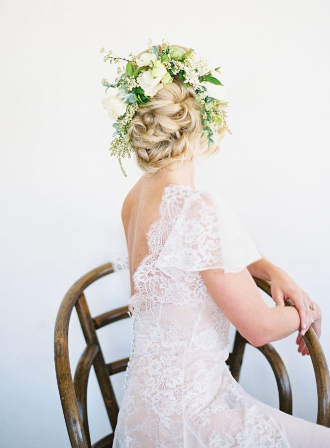 Greenery wedding updo hairstyle: http://www.stylemepretty.com/2017/04/18/kayla-barker-bows-arrows-floral-photography-workshop-joshua-tree/ Photography: Kayla Barker - http://www.kaylabarker.com/