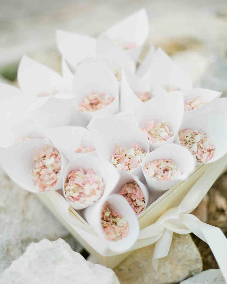 Trending Now: Wedding Ceremony Petal Bars | Martha Stewart Weddings - Pre-arrange color-coordinated cones of flower petals for guests to easily grab on their way into the ceremony. It's mess-free and makes for an incredible display. Consider offering a few different color combos so guests can still have a choice even if they aren't building their own mix.