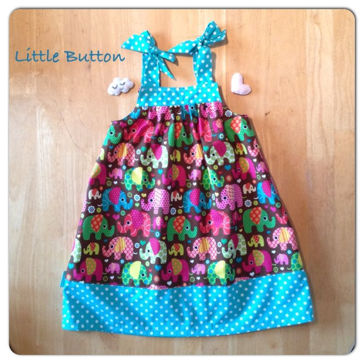 Girls sun dress with elephant print and teal polka hem and straps.