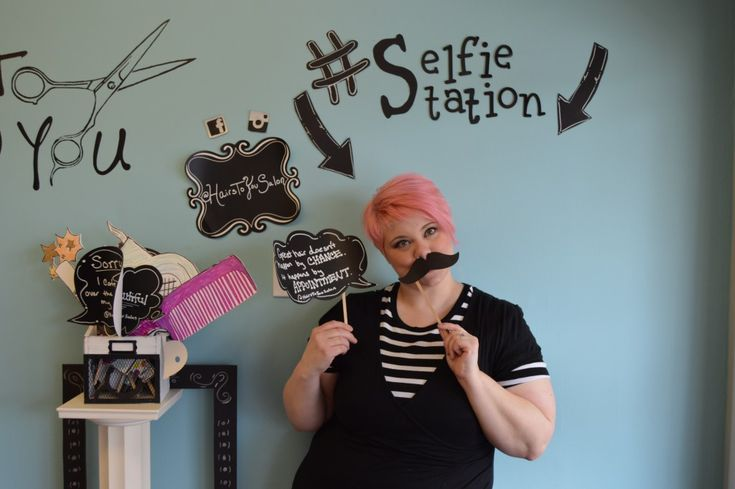 Paige plays in the selfie station for her clients to show off their new 'do before they leave.