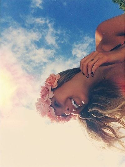 Blue sky as the backdrop..flowers in my hair..senior Picts