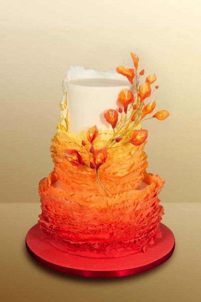 A great fall wedding cake ideas featuring warm ombre' shares of red, orange, and yellow. Cake: Karina Golovin on Craftsy