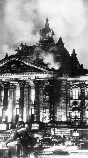 The Reichstag Fire, 27 February 1933. The destruction of the German parliament building was blamed on Communists but may have been a 'false flag' by the Nazis who used it to justify their suppression of political opponents.
